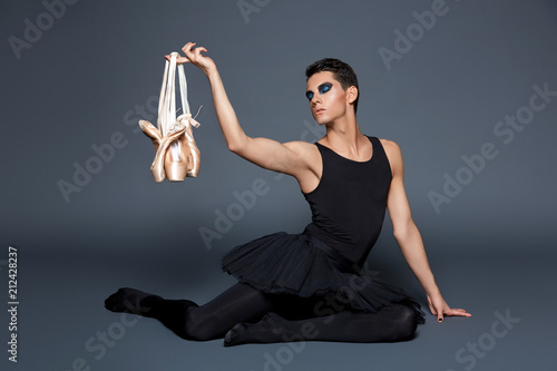 Fototapeta handsome ballet artist in tutu skirt