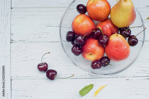 Foto Murales glass transparent vase with fruit and berries