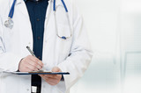 Doctor with a stethoscope, holding a notebook in his hand