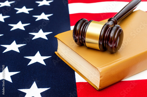 Fototapeta Judge's gavel with law book on american flag.