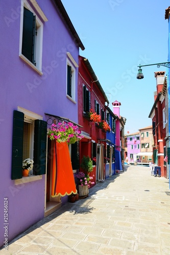 Fotobehang Smalle straatjes Street with colorful buildings and houses in Burano island, Venice, Italy - Famous Architecture and landmarks