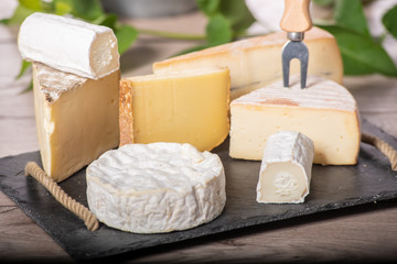different french cheeses on slate plate