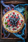 Top view of sweet tart made of berries and mascarpone - 212459443