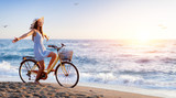 Girl On Bicycle On Beach - Freedom And Carefree Concept