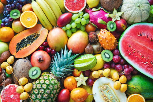 Foto Murales Assortment of colorful ripe tropical fruits. Top view