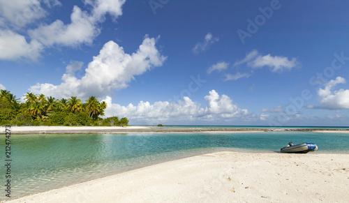 Fotobehang Tropical strand reef ring, lagoon and motu with palm trees on Makemo Atoll, Tuamotus archipelago, French Polynesia, France,