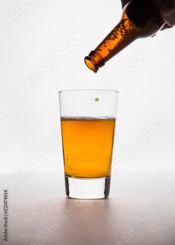 Fototapeta Refreshing beer on a white background