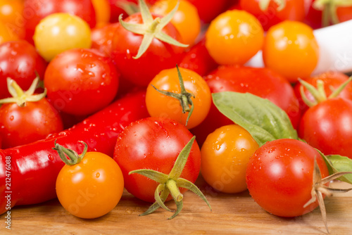 Assortment of cherry tomatoes and peppers - 212476088