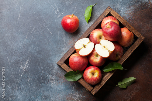 Red apples in wooden box - 212477053