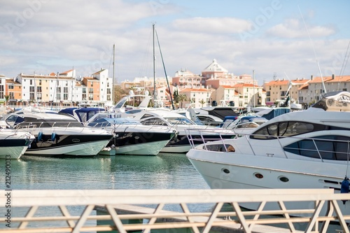 Leinwanddruck Bild Marina with luxurious yachts and sailboats in touristic Vilamoura, Algarve, Portugal