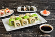 Fresh and tasty sushi on dark background. It can be used as a background - 212494630