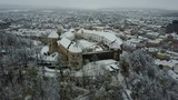 Rotating aerial footage of Ljubljana palace covered in snow, medieval architecture in Slovenia Europe - 212502887