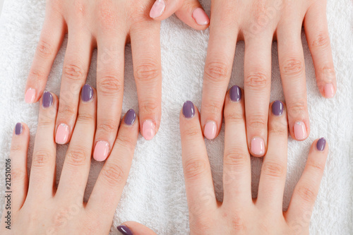 Aluminium Manicure Woman presenting her beautiful painted gel hybrid nails