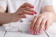 Closeup shot of hands applying moisturizer. Beauty woman holding a glass jar of skin cream - 212510635