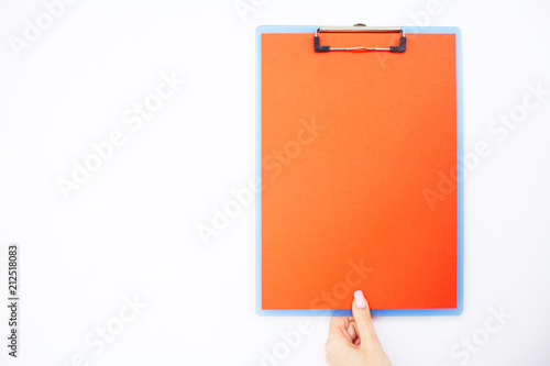 Blank Folder with Red Paper. Hand that Holding Folder and Pen on White Background. Copyspace. Place for Text.