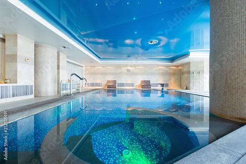 Leinwanddruck Bild Indoor swimming pool in hotel spa center