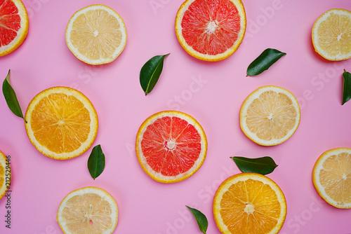 Grapefruit Orange Lemon Leaves Citrus Pattern on Pink Background Minimal Flat Lay - 212529446