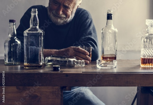 Elderly man drinking alcohol - 212534856