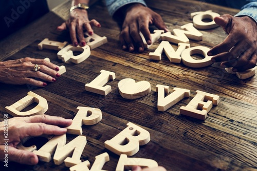 A wooden alphabet love word on the table - 212534868