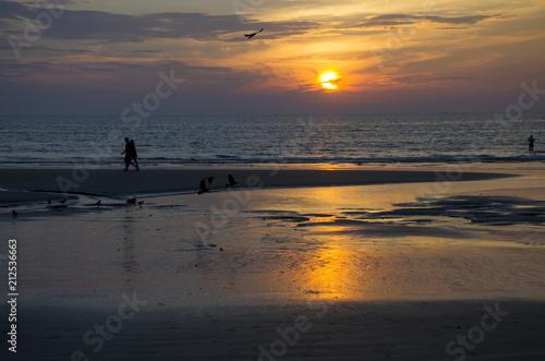 Aluminium Grijze traf. Beautiful landscape an orange sunset at the sea