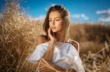 Beautiful blonde girl in a wheat field