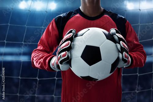 Leinwanddruck Bild Soccer goalkeeper holding soccer ball