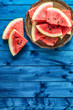 Top of view pieces of fresh watermelon on blue table - 212550631
