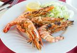Fried shrimps on a plate - 212560438