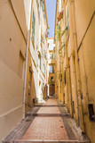 Narrow street in Menton, South of France - 212560439
