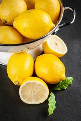 Fresh lemons with green leaves