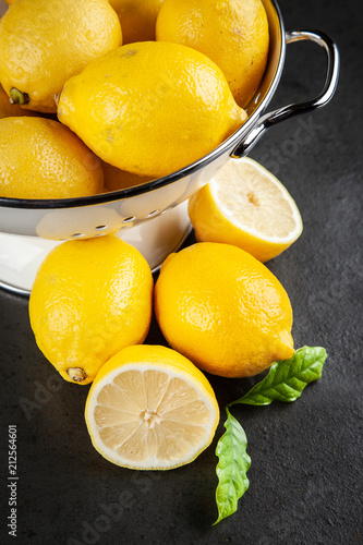 Fresh lemons with green leaves - 212564601