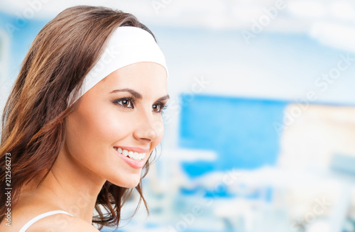 Fotobehang Fitness Portrait of young smiling woman at fitness club