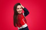 Stylish smiling woman touching hair - 212566889