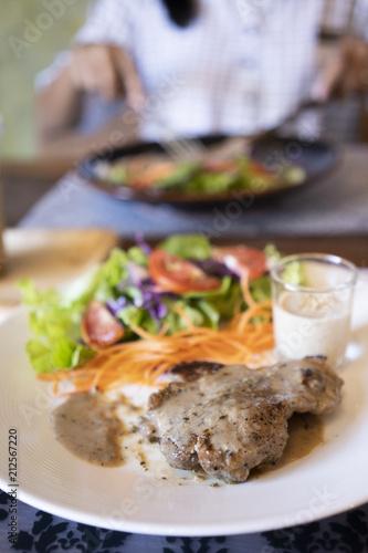 Aluminium Steakhouse Steak and Salad in Plate.