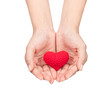 hands holding red crocheted heart isolated on white background