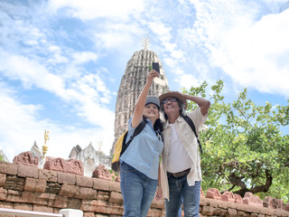 Retired couple selfie together summer traveler concept.