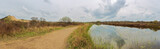 Panoramic view in the nature reserve De Westhoek with sand dunes and a pond