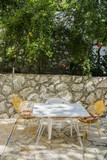 dining table on the old Greek street in summer - 212575690