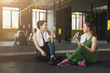 Fitness women drinking water at gym