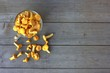 Chanterelles in a Glass Mug On Wooden Background