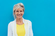 Leinwanddruck Bild - Happy vivacious older blond woman