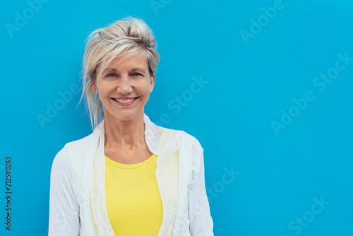 Leinwanddruck Bild Happy vivacious older blond woman