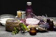 Aromatic composition of lavender, herbs, cosmetics and salt on a dark table top - 212581476