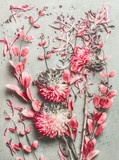 Summer floral flat lay composition made with colorful pastel garden flowers, petals and leaves on desktop background, top view - 212587044