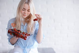cute girl eating cherry / concept healthy eating, happy sexy young adult model and cherry berries - 212588483