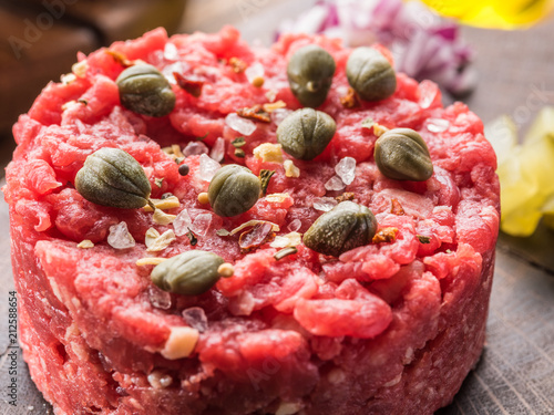 Wall mural Steak tartare served with capers, pickled cucumbers and chopped onion.