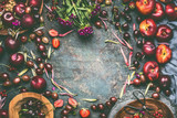 Summer berries and fruits: strawberries, peaches, plums, cherries, gooseberries, currants  on rustic kitchen table background with flowers and plates, top view, flat lay. Organic local  food , frame - 212588815