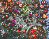 Various summer berries and fruits: strawberries, Peaches, plums, cherries, gooseberries, currants  on rustic kitchen table with flowers and plates, top view, flat lay. Organic local  food and eating - 212588857