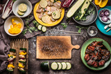 Preparation of various homemade meat vegetables skewers for grill or bbq on rustic background with ingredients , plates, cutting board and kitchen tools, top view, flat lay. - 212589258