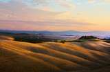 typical Tuscany landscape; sunset over rolling hills and Tuscany village - 212589411
